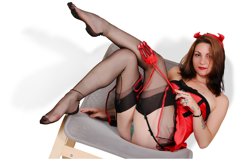 Hot Devil cosplayer in stockings showing her delicious feet